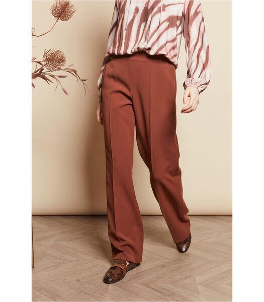 Pantalon en brun rouille avec des jambes de pantalon lar