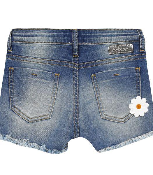 Short en jean avec fleurs