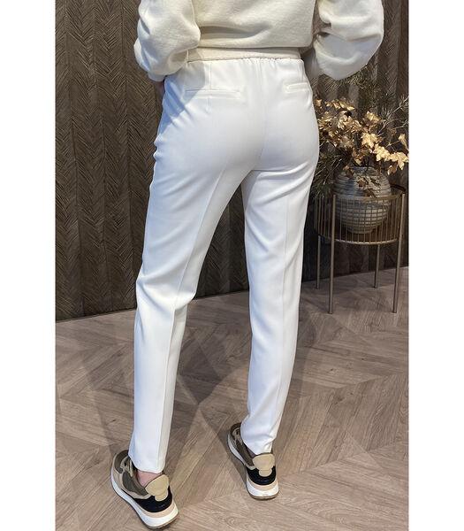 Pantalon en crème avec des jambes de pantalon assez étro
